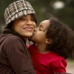 AfricanAmericanMomDaughterKissMedium